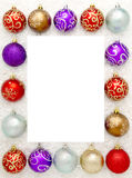 Christmas baubles. A border of Christmas baubles with copy space in the centre Royalty Free Stock Photography