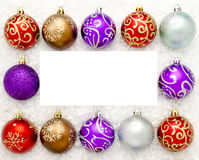 Christmas baubles. A border of Christmas baubles with copy space in the centre Stock Photo