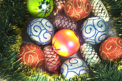 Christmas baubles. Many Christmas baubles and cones Stock Image