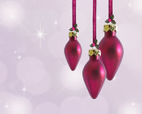 Christmas Baubles. With holly and ribbon with space for text Royalty Free Stock Photo