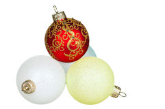 Christmas baubles. Red, green, blue, yellow - isolated on white background royalty free stock photography