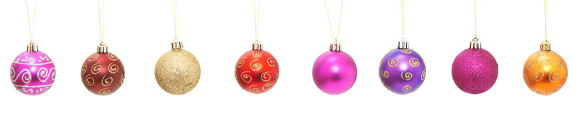 Christmas baubles. Colorful christmas baubles on white for your designs Royalty Free Stock Photos