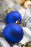 Christmas baubles. Blue Christmas balls or baubles on white silky background Stock Photography