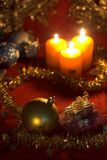 Christmas baubles. Christmas decoration with baubles and candle close up Royalty Free Stock Image