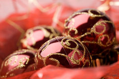 Christmas baubles. Bright red christmas baubles in shiny fabric Royalty Free Stock Photo