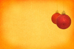 Christmas baubles. On old paper texture background Stock Image