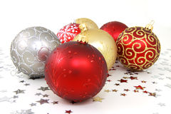 Christmas baubles. On white background with silver stars Stock Photography