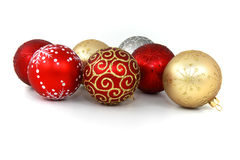 Christmas baubles. Seven various glass christmas baubles on pure white background Stock Image