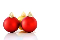 Christmas Baubles. Red and gold Christmas baubles on a white background stock photography