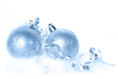 Christmas Baubles. Ice-blue Christmas baubles and ribbon, on white fur Stock Photography
