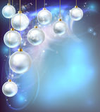 Christmas Baubles Abstract Background. Blue and silver abstract Christmas bauble decoration ornaments festive design background Royalty Free Stock Images