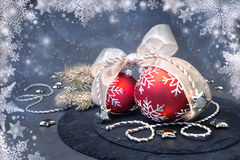 Christmas baubles on abstract winter background. Red and white Christmas decorations on abstract winter background. Shallow DOF, focus on the left ball and part Stock Photography
