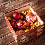 Christmas baubles against a wooden table Stock Image