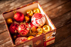 Christmas baubles against a wooden table Stock Photo