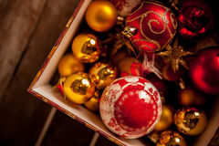 Christmas baubles against a wooden table Royalty Free Stock Photo