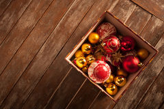 Christmas baubles against a wooden table Stock Images