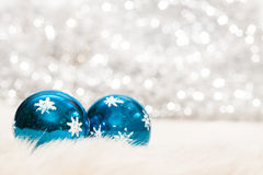 Christmas baubles background. Christmas baubles on background of defocused lights Stock Photo