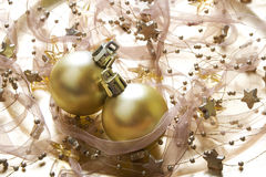 Christmas baubles background. Golden christmas baubles on glowing background with stars Stock Photo