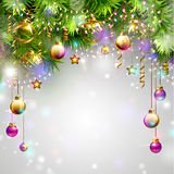 Christmas baubles. Christmas backgrounds with evening balls, garlands and fir-trees branches Royalty Free Stock Photography