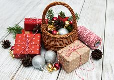 Christmas baubles in basket Stock Photos