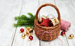 Christmas baubles in basket Royalty Free Stock Images