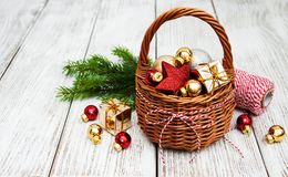 Christmas baubles in basket. On wooden table Royalty Free Stock Photography