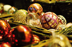 christmas baubles in the basket Royalty Free Stock Photos
