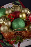 Christmas baubles in a basket Stock Image
