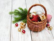 Christmas baubles in basket. On wooden table Royalty Free Stock Photo
