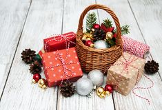Christmas baubles in basket. On wooden table Stock Photography
