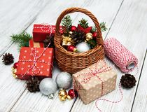 Christmas baubles in basket. On wooden table Royalty Free Stock Photos