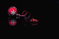 Christmas baubles on black background Royalty Free Stock Image