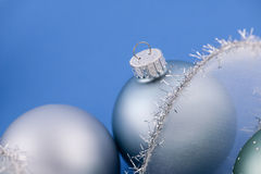 Christmas baubles on blue Stock Photography