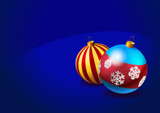 Christmas baubles on blue background Stock Photography