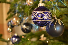 Christmas baubles. Blue baubles hanging from Christmas tree Stock Images