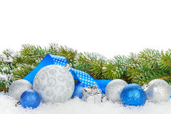 Christmas baubles and blue ribbon with snow fir tree Royalty Free Stock Image