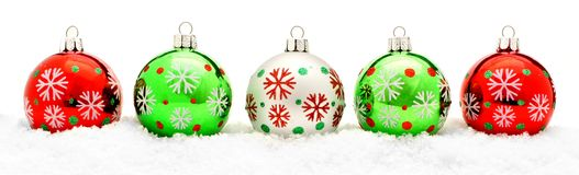 Christmas baubles. Border of colorful Christmas baubles in fresh snow Royalty Free Stock Photography