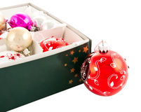 Christmas baubles in box. Set of colorful Christmas balls or baubles in box; isolated on white background Royalty Free Stock Photography