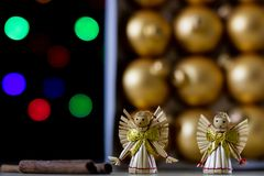 Christmas baubles in a box against a background of Christmas lig Stock Image