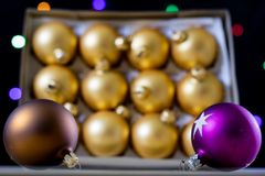 Christmas baubles in a box against a background of Christmas lig Stock Photo
