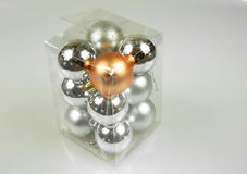 Christmas baubles in a box on a white background.Horizontal. Royalty Free Stock Photo