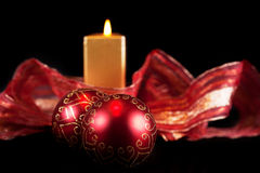 Christmas baubles and candle Royalty Free Stock Photo