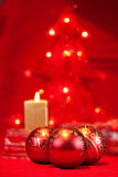 Christmas baubles and candle Stock Photography