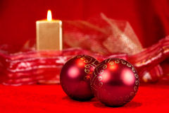 Christmas baubles and candle Stock Image