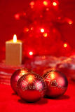 Christmas baubles and candle Royalty Free Stock Photos