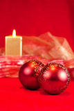 Christmas baubles and candle Stock Photos