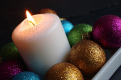 Christmas baubles and candle Royalty Free Stock Photography