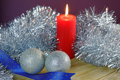 Christmas Baubles and Candle with Tinsel Royalty Free Stock Images