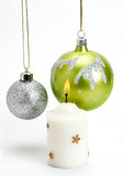 Christmas Baubles and Candle on a white background Royalty Free Stock Images