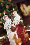 Christmas baubles, candles and other on background of defocused Royalty Free Stock Images